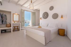 A bed or beds in a room at Halara Studios