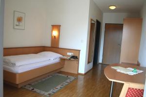Кровать или кровати в номере Hotel Cafe Lorenz