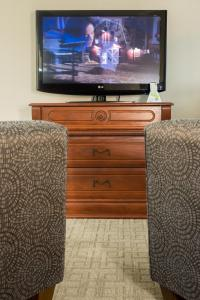 A television and/or entertainment center at Capital Hill Hotel & Suites