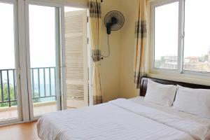 Giường trong phòng chung tại Hanvet Tam Đảo Hotel