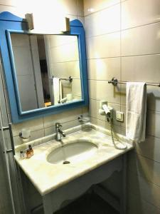Een badkamer bij Hotel Atrium