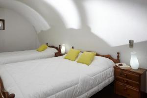 Letto o letti in una camera di Anna Traditional Apartments