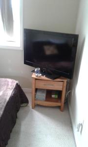 A television and/or entertainment center at Cozy pet friendly Home