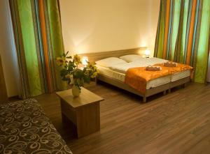 Łóżko lub łóżka w pokoju w obiekcie Willa Słonecznik
