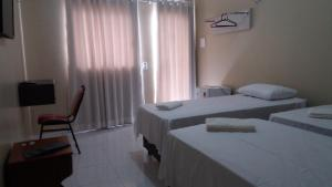 A bed or beds in a room at Hana Praia Hotel