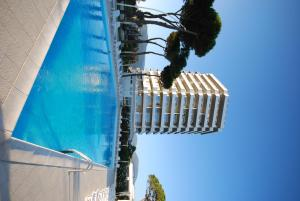 The swimming pool at or near Torre Del Sole