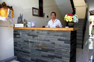 The lobby or reception area at Dewi Ayu Accommodation