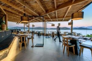 A restaurant or other place to eat at Royal Marmin Bay Boutique & Art Hotel
