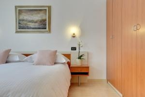 A bed or beds in a room at Villa NiNa Rovinj B&B