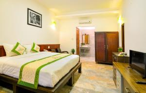 A bed or beds in a room at Fig Tree Boutique Villa