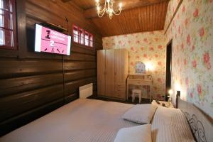 Кровать или кровати в номере Комплекс Большая Волга