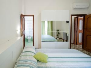A bed or beds in a room at Bed & Breakfast Antonello