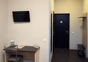 Телевизор и/или развлекательный центр в Отель Вилга