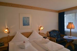 Ein Bett oder Betten in einem Zimmer der Unterkunft Parkhotel zum Stern
