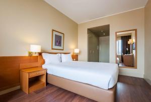 Cama ou camas em um quarto em Hotel Fundador