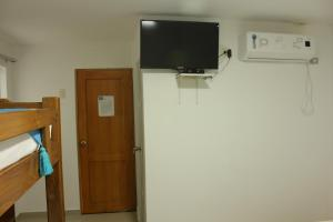A television and/or entertainment center at Hotel Brisas del Nare