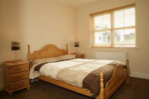 A bed or beds in a room at Downings Coastguard Cottages - Type B-E