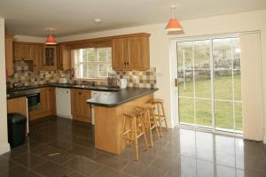 A kitchen or kitchenette at Downings Coastguard Cottages - Type B-E