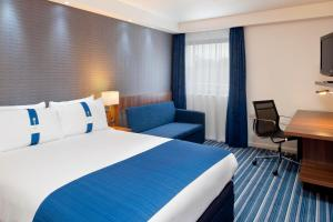 A bed or beds in a room at Holiday Inn Express London City, an IHG Hotel