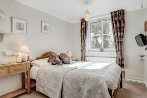 A bed or beds in a room at South Norfolk Guest House