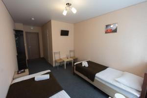 Кровать или кровати в номере Inn Chemodan