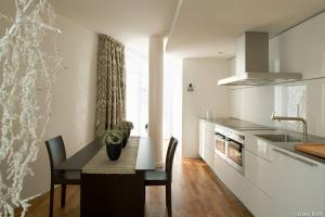 A kitchen or kitchenette at The Mandala Hotel
