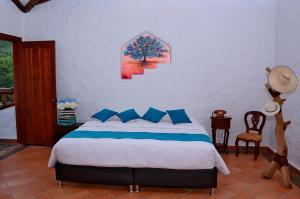 Uma cama ou camas num quarto em Hotel Estorake San Agustin Huila