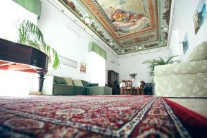 Letto o letti in una camera di NapoliMia Hotel