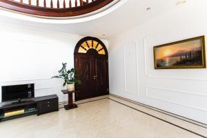 Телевизор и/или развлекательный центр в Guest House RLtennis