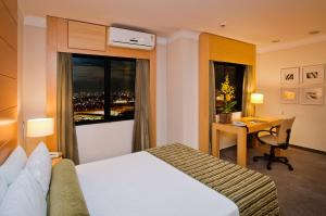 A bed or beds in a room at Nobile Suites Congonhas
