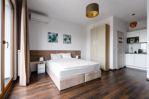 Łóżko lub łóżka w pokoju w obiekcie Park Avenue Apartments