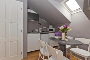 A kitchen or kitchenette at Royal Prague City Apartments