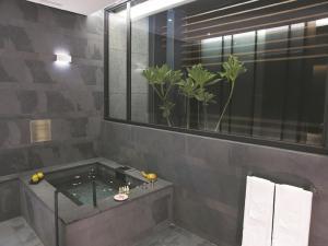 A bathroom at The Sun Hot Spring & Resort
