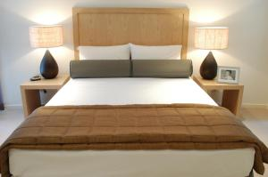 A bed or beds in a room at Cilento Mooloolaba