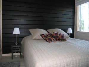 Vuode tai vuoteita majoituspaikassa Holiday Home Haukilahti