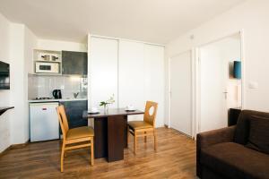 A kitchen or kitchenette at Séjours & Affaires Caen Le Clos Beaumois