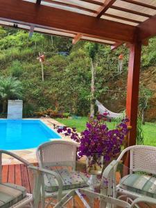 The swimming pool at or close to Loft Aconchego da Serra