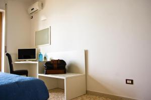 A television and/or entertainment centre at Terrazza Marconi