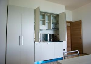 A kitchen or kitchenette at Terrazza Marconi