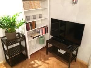 A television and/or entertainment center at Historical Wine Apartment