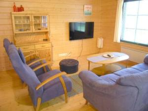 A seating area at Holiday Home Pilvilinna