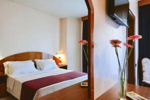 A bed or beds in a room at Bajamar Beach Hotel