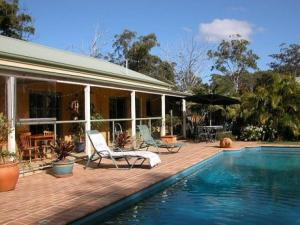 The swimming pool at or near Smoky Cape Retreat