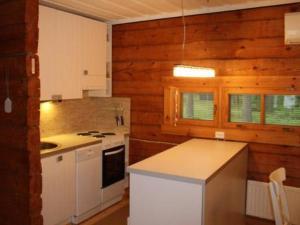A kitchen or kitchenette at Holiday Home Hiekkaranta