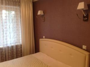 Кровать или кровати в номере Apartment Ostrovskogho 37