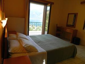 Cama o camas de una habitación en Forkis Apartments