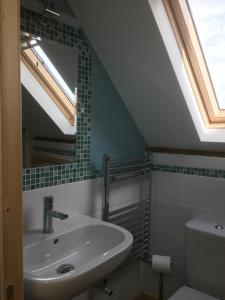 A bathroom at Honeycomb House Apartments