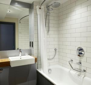 A bathroom at New Inn by Greene King Inns