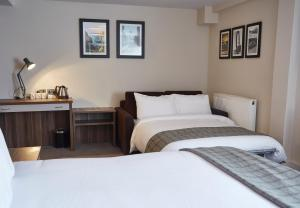 A bed or beds in a room at New Inn by Greene King Inns