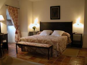 Cama o camas de una habitación en Hotel Puerta de la Luna